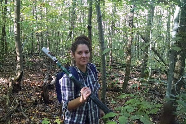 photo of young woman in the woods with soil sampler