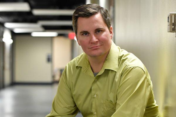 white man in light green shirt