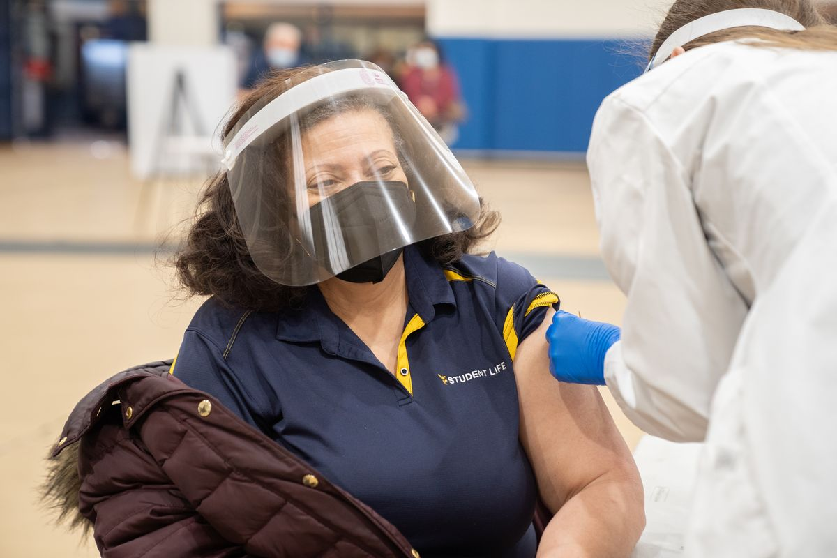 Black woman receives COVID-19 vaccine