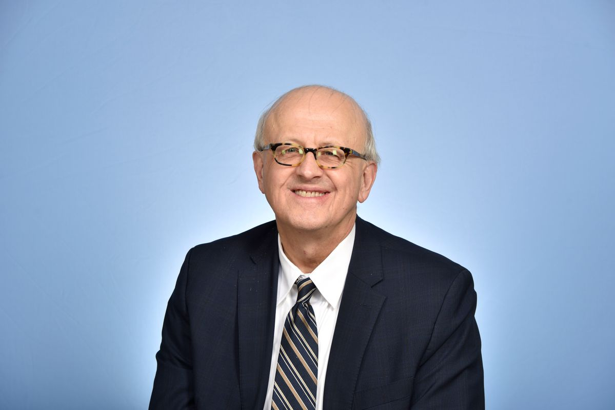 photo of man in glasses and suit and tie