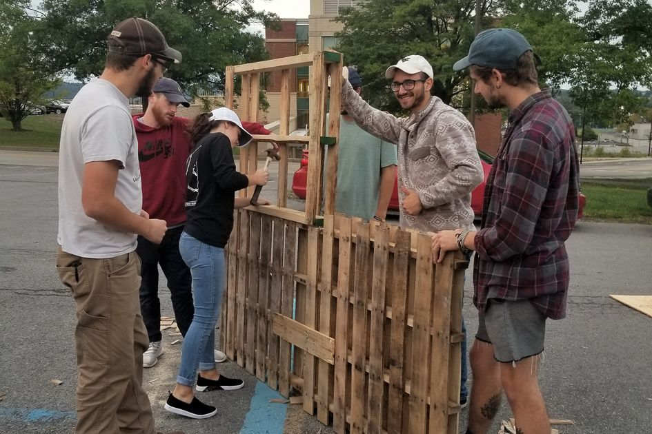 Men and women build a frame for landscaping