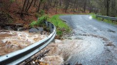 Flooding damages a road