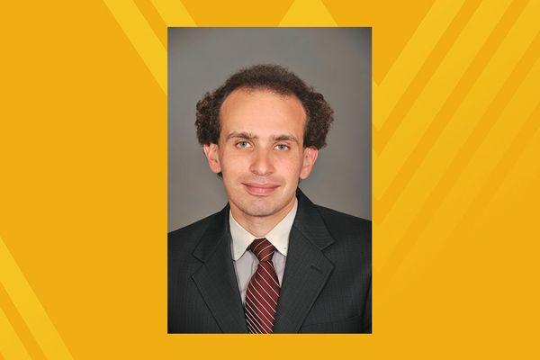 Photo of V'yacheslav Akkerman on gold background