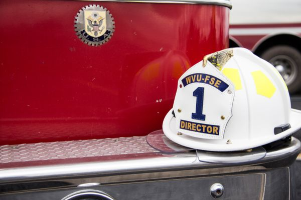 Firefighter hat on the edge of a fire truck.