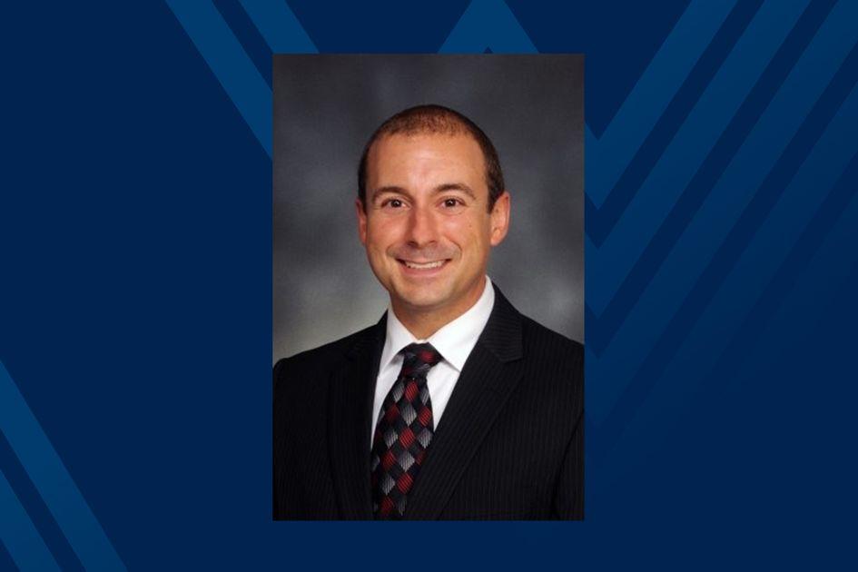 A photo of Mark Garofoli on a blue background