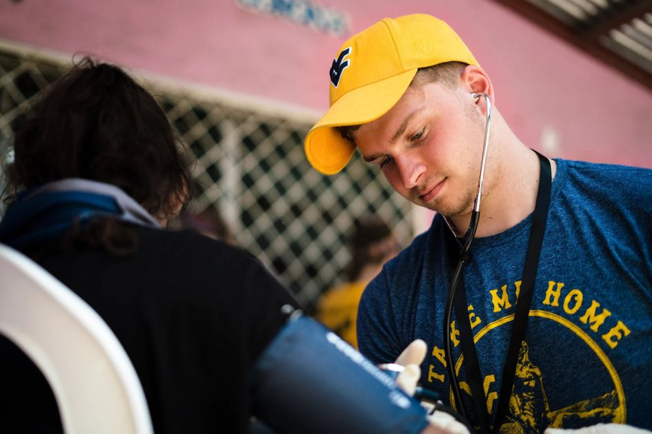 WVU student provides care to a person in Nicaragua as part of the Global Brigade