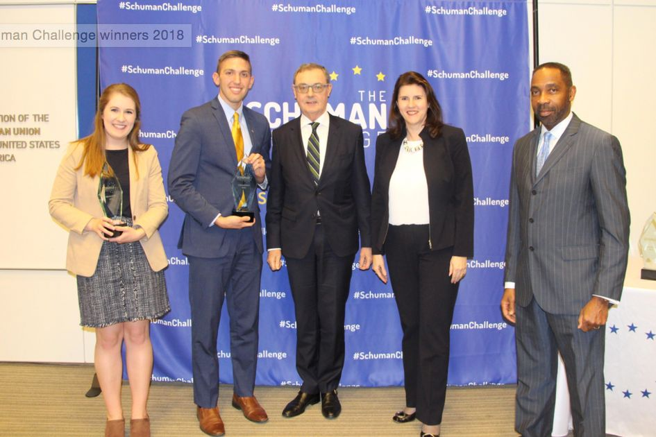 WVU students Morgan King (L) and Garrett Burgess (L) hold Schuman Challenge trophies with David O'Sullivan, European Union Ambassador to the United States Sylvie Lucas, Luxembourg Ambassador to the United States J.J. Green, National Security Correspondent at WTOP and Host of the Target/USA Podcast.