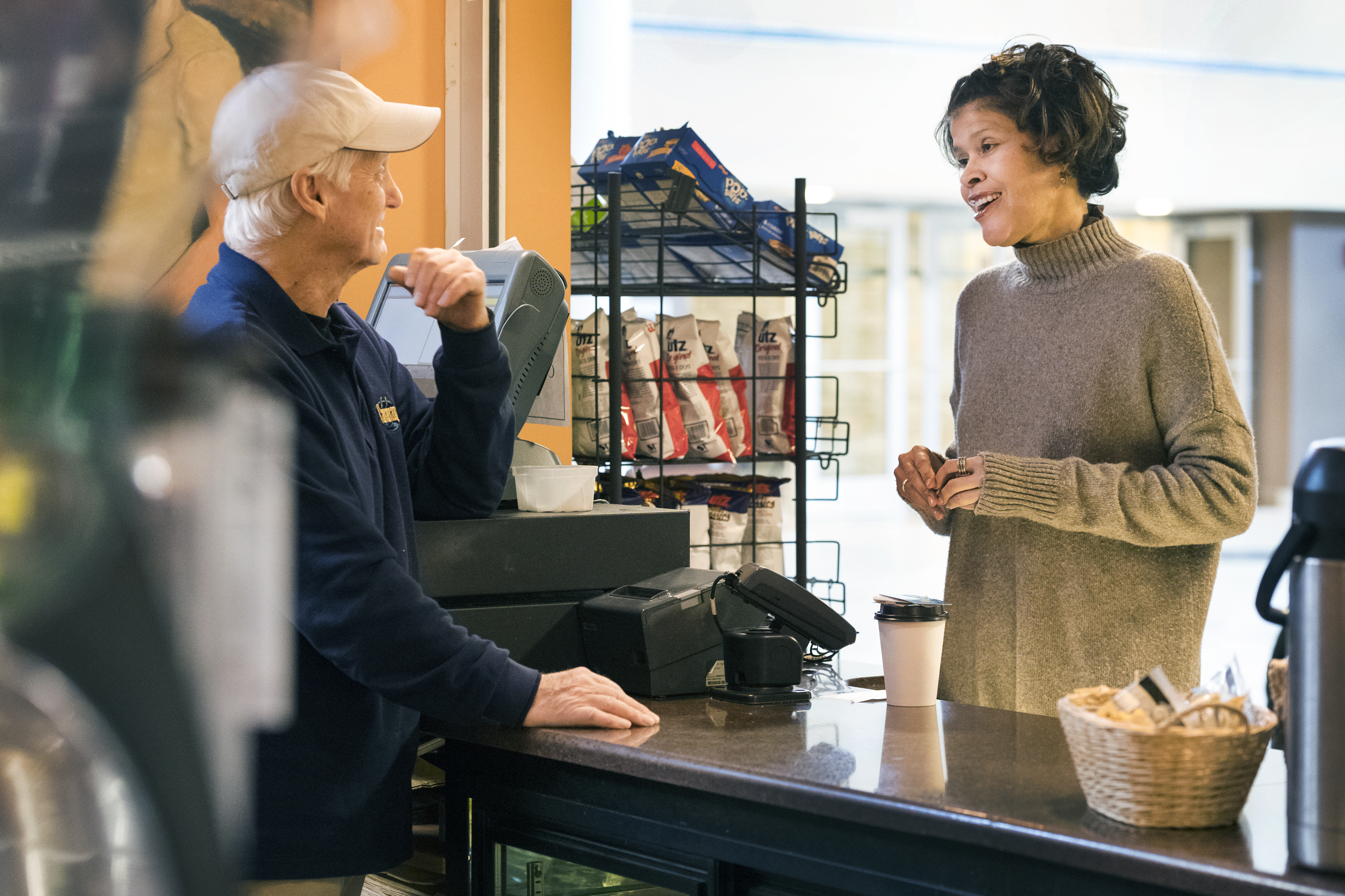 Lauri Andress (right), an assistant professor in the WVU School of Public Health, studies rural residents' access to healthy food. Shown here during a visit to Cavanaugh's coffee shop, at the Robert C. Byrd Health Sciences Center, Andress is interested in infrastructure investments, economic development and employment opportunities that can improve food access for the rural elderly.