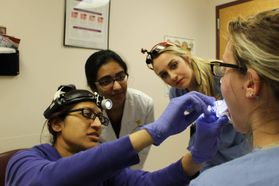 WVU School of Dentistry students examine a patient