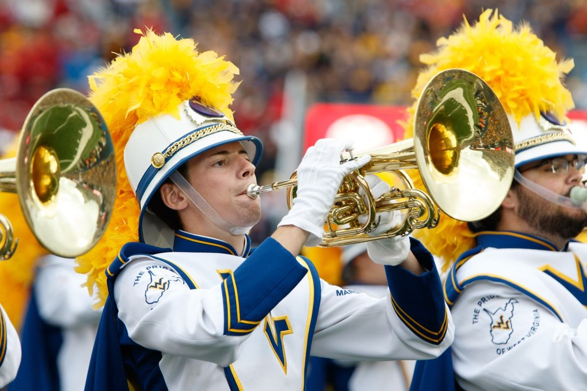 march band member playing a brass instrument in uniform