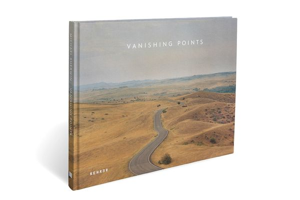 Book with a winding road on the cover.