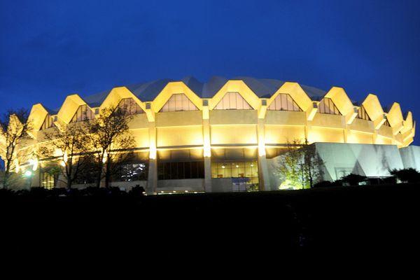 glowing circular basketball stadium at night