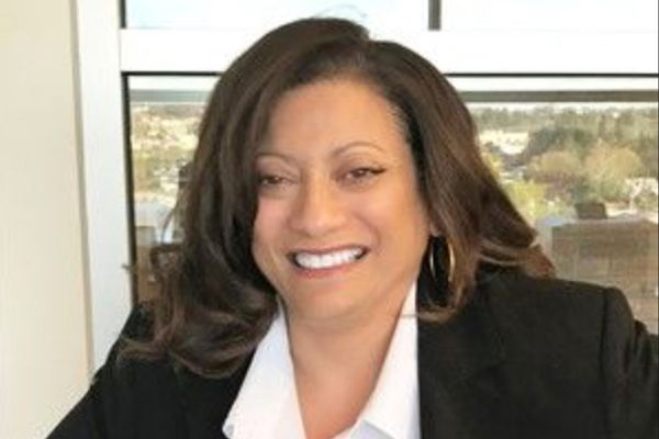 smiling woman, long dark hair, dark jacket, white blouse