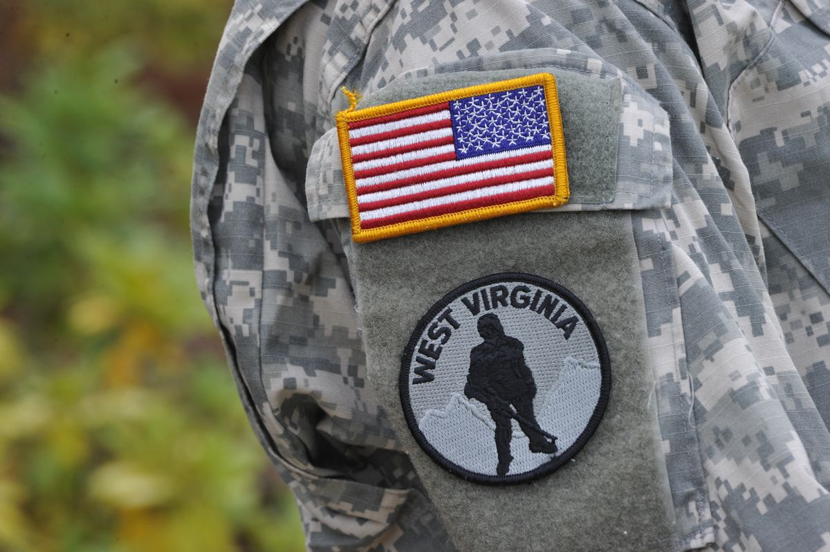 Sleeve of an ROTC uniform with American flag and West Virginia patch with a soldier in sillhouette
