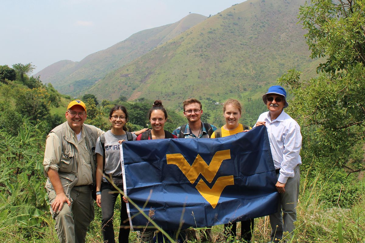Professional engineer Rodney Holbert and WVUEWB members Esther Raub, Alexis Zini, Dustin Freeman, Morgan King, and Majid Jarid display the WVU flag from the Rwenzori Mountains in Uganda.