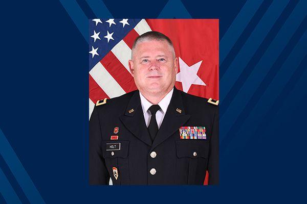 man in uniform on blue background