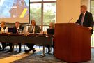 Rob Alsop behind a podium with a microphone speaks to WVU Board of Governors