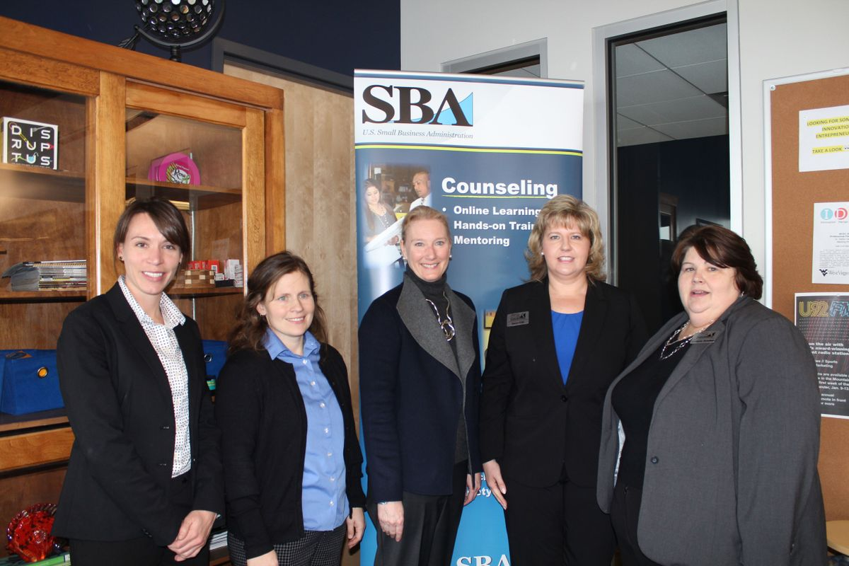 From left to right are Laura Maas, Program Manager  Office of Women's Business Ownership- Small Business Administration, Andrea McCardle, Director, WVU Women's Business Center, Melinda Walls, Assistant Vice President of Innovation and Entrepreneurship at WVU, Karen Friel, District Director, Small Business Administration WV District Office, and Kim Donahue District Office Technical Representative and Small Business Administration Development Specialist for Southern WV.