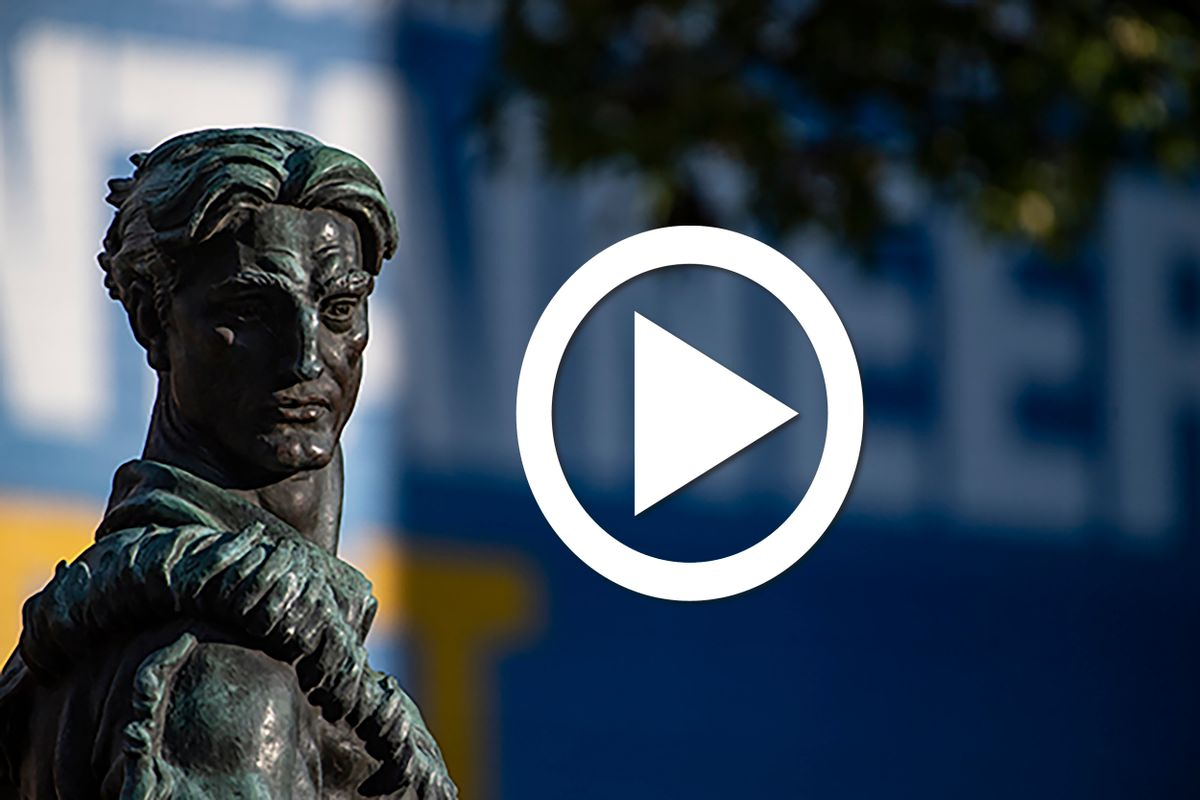 mountaineer statue face/head with play button