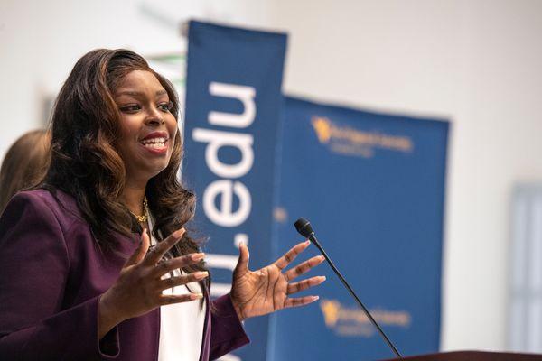 Black woman speaks at a podium