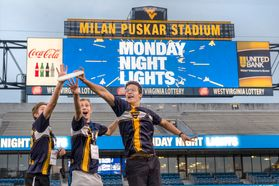 Students play Frisbee on Mountaineer Field