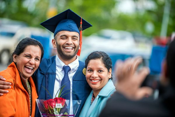 Shantan Malagaveli (mother), Rohan Malagaveli and Chaitanya Malagaveli (aunt) pose for a picture after The Statler College of Engineering  Commencement at the Coliseum May 13th, 2017.