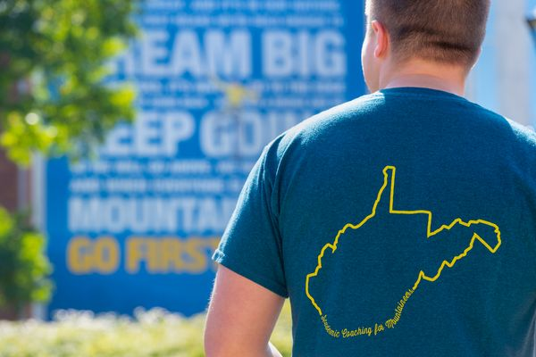 man wearing t-shirt with outline of West Virginia on the back