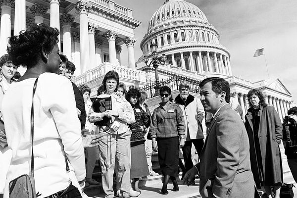 Photograph of Congressman Nick Rahall with a group of West Virginia students on the steps of the Capitol building, April 7, 1987, from the Congressman Nick Joe Rahall II papers, West Virginia & Regional History Center, WVU Libraries