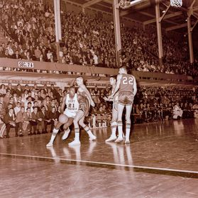 black and white photo of a basketball game