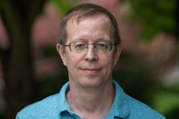 photo of man wearing glasses