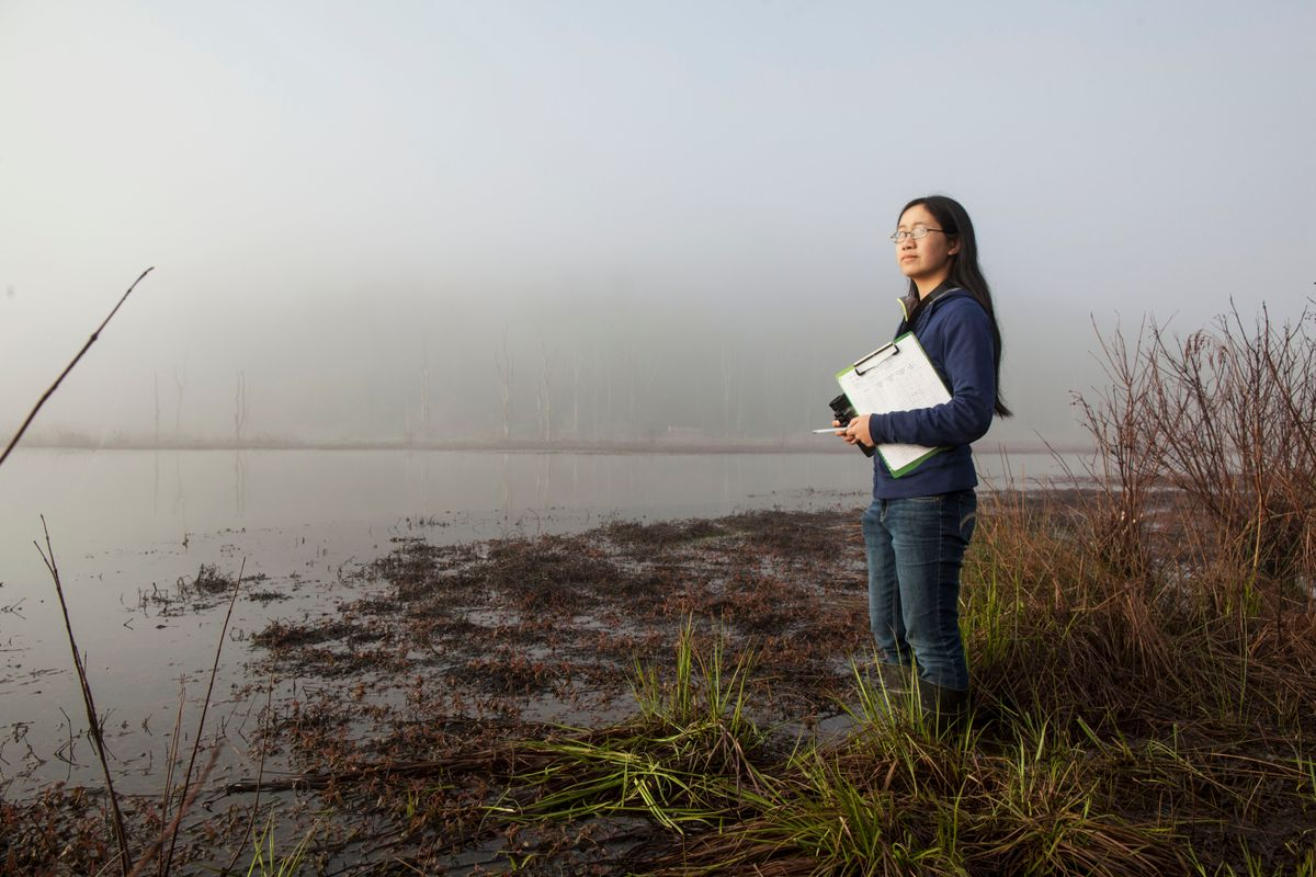 Woman standing near a body of water