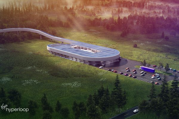 rendering of large building, parking lot, track