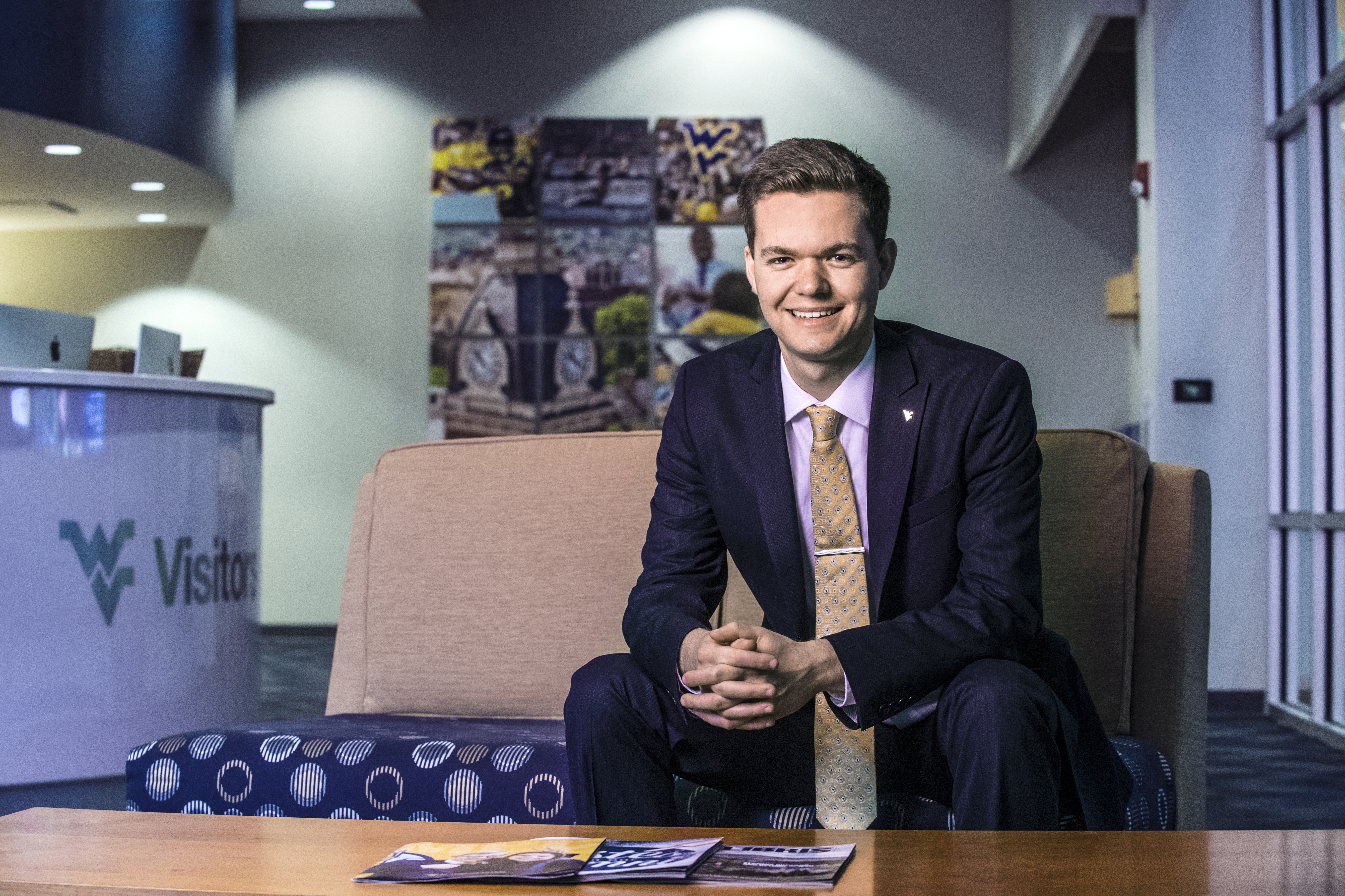 Dillon Muhly-Alexander sits in the WVU Visitors Center