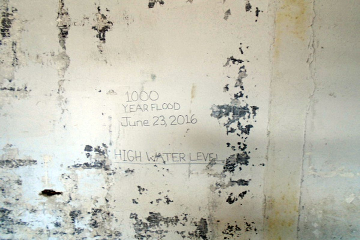 Wall with damage marking how high flood waters were