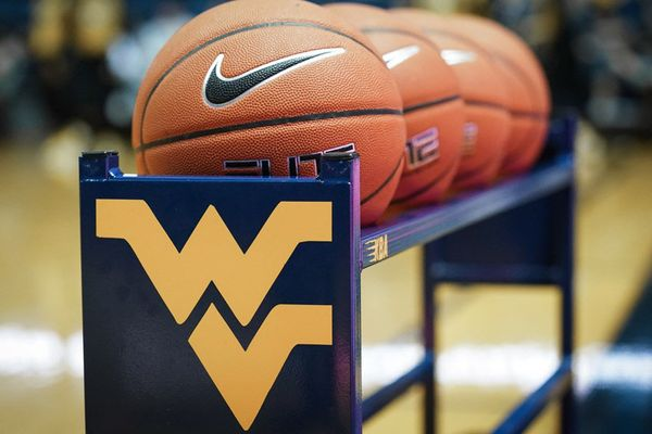 Basketballs on a stand with a WVU logo