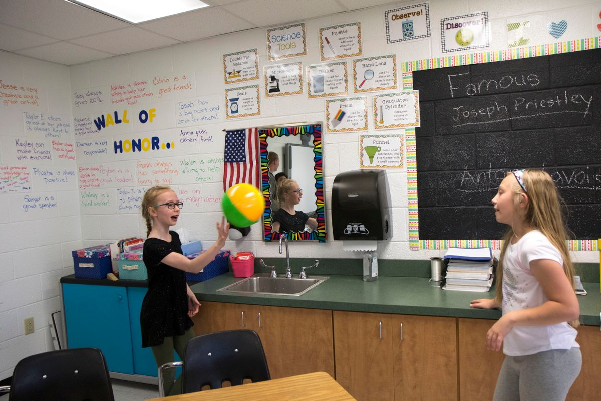 Two girls play in standard classroom