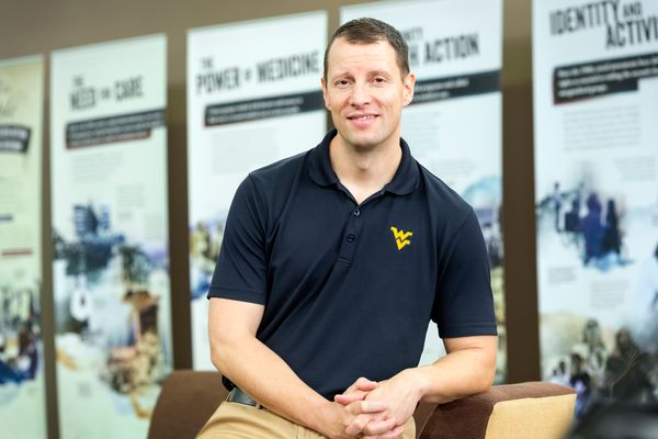 photo of smiling man in flying WV polo