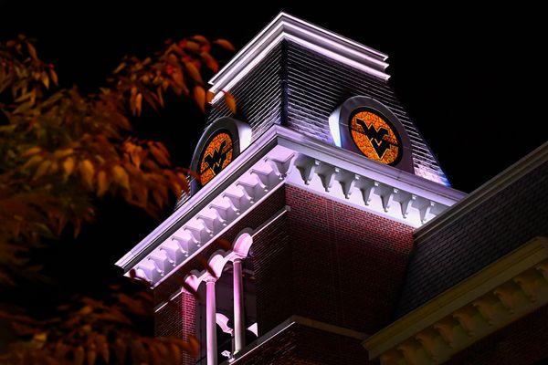 Erickson Alumni Center tower features stained glass WVU logo