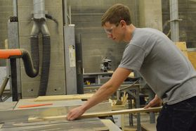 Byron Utley works on a stage set in the WVU College of Creative Arts technology and design department.