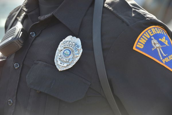 Photo of a uniform shirt with badge and patch
