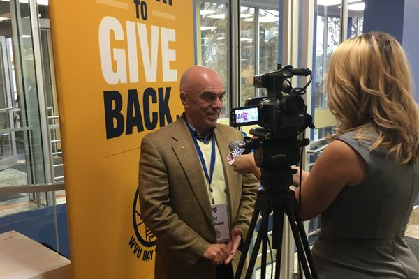 B.J. Davisson is interviewed by a tv reporter