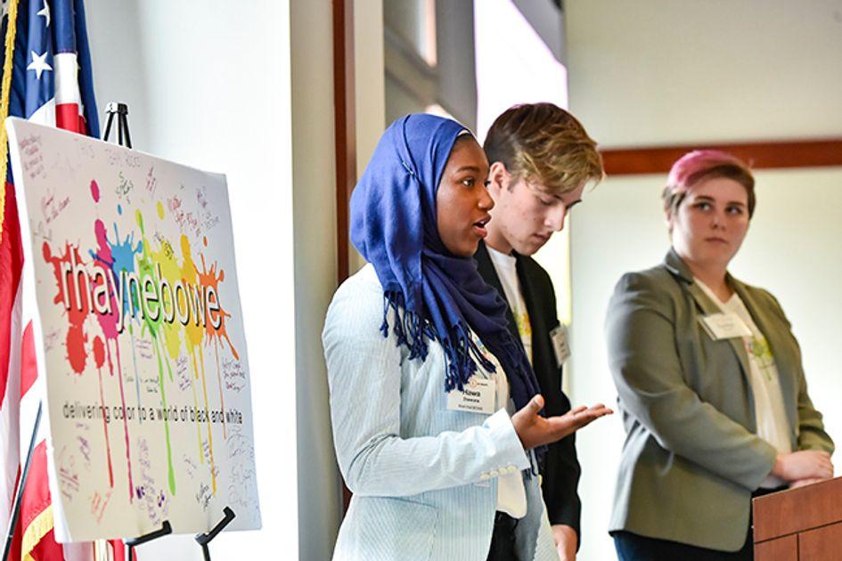 Three students make a presentation