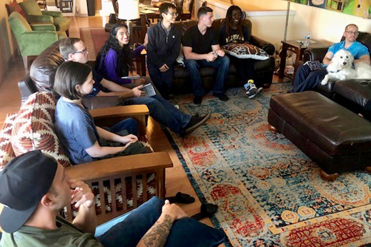 young people sit together in living room atmosphere