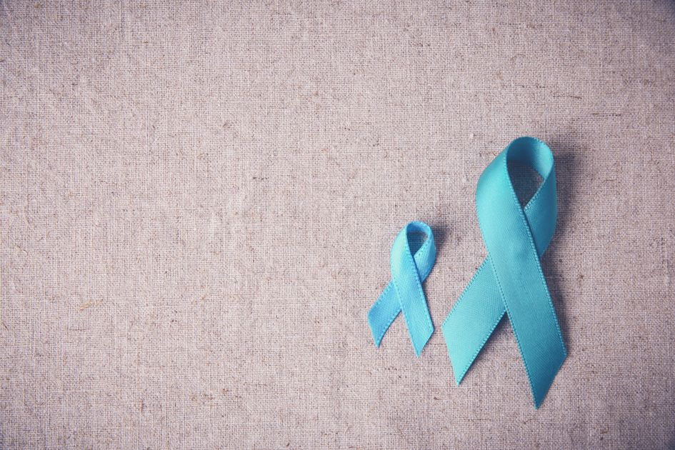 Two teal ribbons on dun colored background