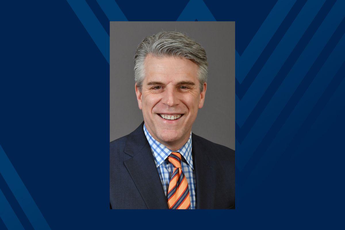 Photo of Greg Bowman on blue background