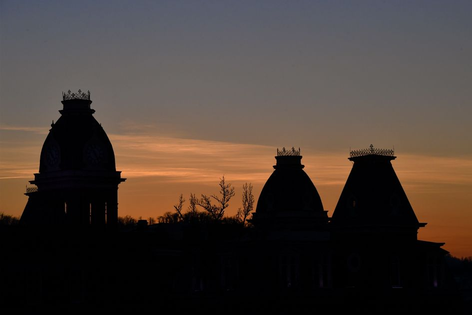 Three cupolas  silhouetted at dusk