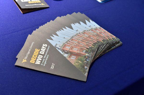 Decide WVU Days brochures on blue background