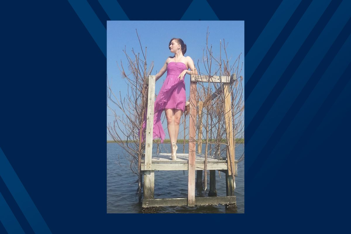 A ballerina on pointe stands in a duck blind