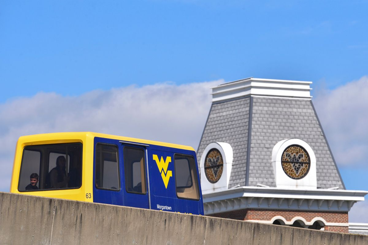 PRT car passing by the WVU Alumni Center tower