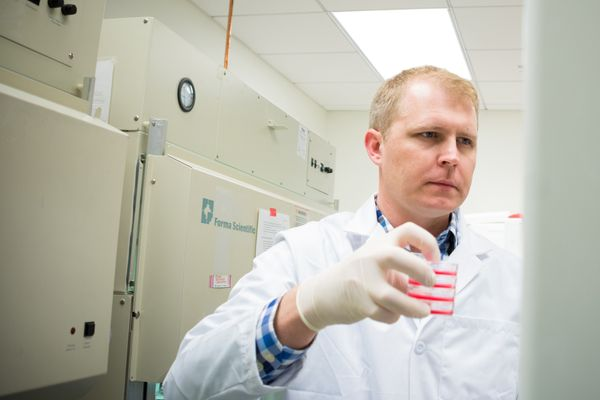 Photo of a man in a white lab coat